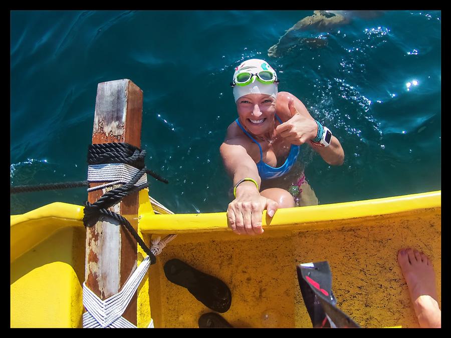 Female Triathlet in Ocean waiting on a boat