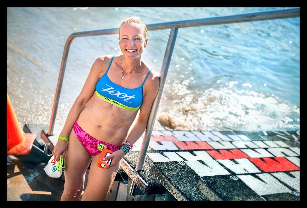 Female Triathlet in Ocean after swim training at the beach