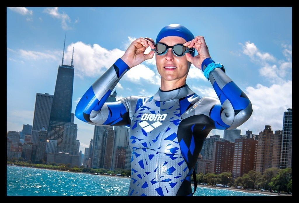 Female Triathlete in Arena Wetsuit and Cobra Tri Googles and with Garmin Forerunner 945