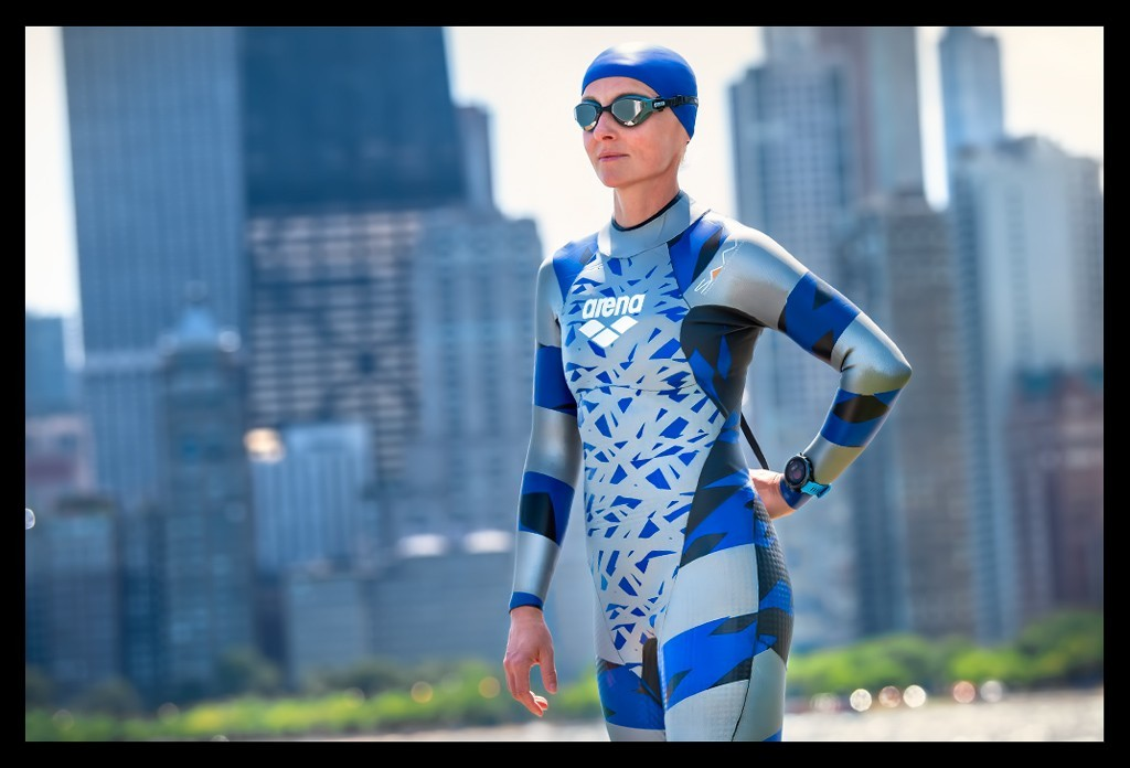 Female Triathlete in Arena Wetsuit and with Garmin Forerunner 945