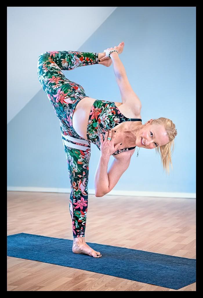 Yoga Asana Half Moon Bow Women on Yoga mat smiling
